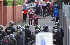 13/7/13 PACEMAKER PRESS BELFAST. Heavily armed riot squad PSNI officers stand firm as serious trouble broke out this evening in the Woodvale road area near Ardoyne. Picture Charles McQuillan/Pacemaker.