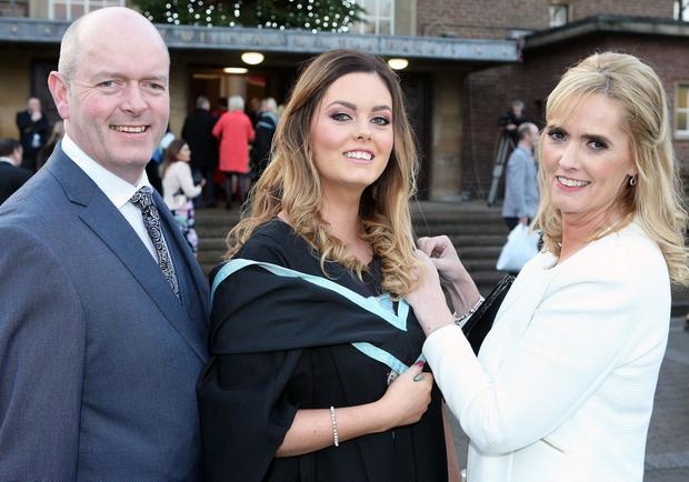 Graduations take place at Queens University in Belfast. Sarah-Louise Gilbert from Larne who graduated iin Nursing pictired whith her parents Mark and Sharon Gilbert.