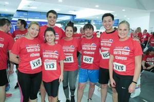GRANT THORNTON RUNWAY RUN SCALES NEW HEIGHTS The team from Baker McKenzie get warmed up for last nightÕs Grant Thornton Runway Run at Belfast City Airport. The hugely-popular event attracted a record number of runners as 600 local businessmen and women took part in the 5k run on the tarmac of the airport. Teams of four from organisations across a wide range of sectors came together for the third year of the leading business advisory firmÕs event. Ê