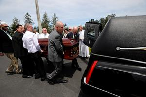 Pallbearers, including Ashley Donohoe's father George Donohoe, right, carry her casket to a waiting hearse following services for Olivia Burke, 21, and Ashley Donohoe, 22, at St. Josephs Catholic Church in Cotati, Calif., on Saturday, June 20, 2015.  The two woman were among the several people killed on Tuesday when a balcony snapped off the fifth floor of a Berkeley apartment building during a birthday party. (AP Photo/Michael Short)