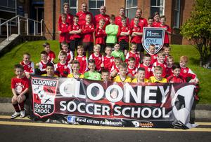 Three teams from the local Clooney Soccer School pictured before taking part in the Hughes Insurance Foyle Cup parade on Tuesday.