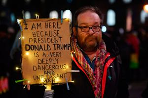 TOPSHOT - Demonstrators protest outside Downing Street against US President Donald Trump in central London on January 30, 2017.  President Trump signed an executive order on January 27, 2016 restricting immigration from seven Muslim countries. / AFP PHOTO / BEN STANSALLBEN STANSALL/AFP/Getty Images