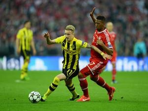 LONDON, ENGLAND - MAY 25:  Marco Reus of Borussia Dortmund (L) in action with Jerome Boateng of Bayern Muenchen during the UEFA Champions League final match between Borussia Dortmund and FC Bayern Muenchen at Wembley Stadium on May 25, 2013 in London, United Kingdom.  (Photo by Laurence Griffiths/Getty Images)