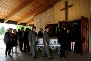 Pallbearers attend to the caskets of Olivia Burke, 21, and Ashley Donohoe, 22, before a service at St. Josephs Catholic Church in Cotati, Calif., on Saturday, June 20, 2015.  The two woman were among the several people killed on Tuesday when a balcony snapped off the fifth floor of a Berkeley apartment building during a birthday party. (AP Photo/Michael Short)