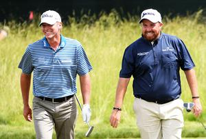 On course: Shane Lowry (right) with Steve Stricker yesterday. Photo: Ross Kinnaird/Getty Images