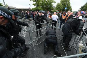 Press Eye - Belfast - Northern Ireland - 12th July 2014 - Picture by Kelvin Boyes / Press Eye.  PSNI officers erect a makeshift barrier at this evenings 12th July return parade at Twaddell Avenue in Ardoyne north Belfast  There was a heavy police presence in the Ardoyne area. No resident protest groups held demonstrations.  It comes after the Parades Commission ruled that the outward parade could proceed, however the evening return leg past the interface has been banned.