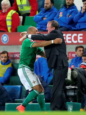 Northern Ireland's Josh Magennis celebrates scoring his side's second goal of the match with Northern Ireland manager Michael O'Neill (right) during the UEFA European Championship Qualifying match at Windsor Park, Belfast. PRESS ASSOCIATION Photo. Picture date: Thursday October 8, 2015. See PA story SOCCER N Ireland. Photo credit should read: Niall Carson/PA Wire.