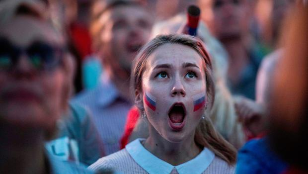 TOPSHOT - A Russian fan reacts as she watches a screening of the Russia 2018 World Cup Group A football match between Russia and Egypt, at the Fan Zone in Nizhny Novgorod on June 19, 2018. / AFP PHOTO / Johannes EISELEJOHANNES EISELE/AFP/Getty Images