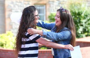 Picture - Kevin Scott / Belfast Telegraph  Belfast - Northern Ireland - Thursday 13th August 2015 - A Level Results Day   Pictured is Niamh Bunting and Kerry Burns during A level results day at St Dominics  Picture - Kevin Scott / Belfast Telegraph