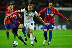 Tottenham Hotspur's English striker Harry Kane (C) vies with CSKA Moscow's Russian midfielder Aleksandr Golovin and CSKA Moscow's Israeli midfielder Bibras Natcho (R) during the UEFA Champions League group E football match between Tottenham Hotspur and CSKA Moscow at Wembley Stadium in north London on December 7, 2016. / AFP PHOTO / Glyn KIRKGLYN KIRK/AFP/Getty Images