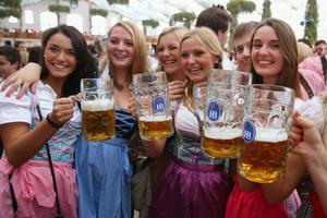 MUNICH, GERMANY - SEPTEMBER 21:  Revellers attend the opening day of he Oktoberfest at Hofbraeu tent on September 21, 2013 in Munich, Germany. The Munich Oktoberfest, which this year will run from September 21 through October 6, is the world's largest beer fest and draws millions of visitors.  (Photo by Alexander Hassenstein/Getty Images)