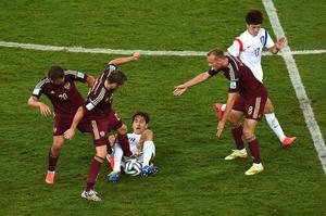 CUIABA, BRAZIL - JUNE 17:  Victor Fayzulin (L) and Dmitry Kombarov of Russia challenge Park Chu-Young of South Korea during the 2014 FIFA World Cup Brazil Group H match between Russia and South Korea at Arena Pantanal on June 17, 2014 in Cuiaba, Brazil.  (Photo by Christopher Lee/Getty Images)