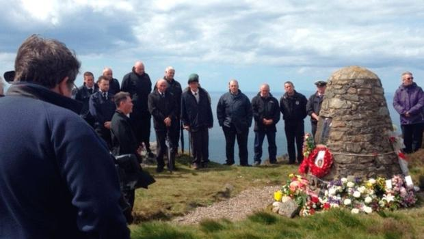People attending a memorial ceremony on the Mull of Kintyre yesterday