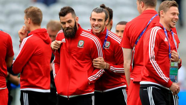 Wales' Gareth Bale (centre, right) with Wales' Joe Ledley (centre, left) during warm-up before the UEFA Euro 2016, quarter final match at the Stade Pierre Mauroy, Lille. PA