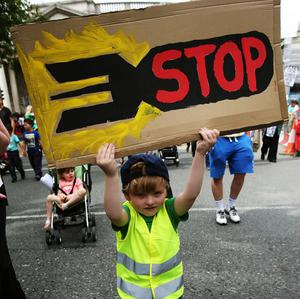 "Jack Aronson, 4, from Dublin, takes part in a protest march through Dublin city centre to call for an end to Israeli military action in Gaza and ""justice and freedom"" for Palestine. PRESS ASSOCIATION Photo. Picture date: Saturday July 19, 2014."