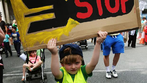 """Jack Aronson, 4, from Dublin, takes part in a protest march through Dublin city centre to call for an end to Israeli military action in Gaza and """"justice and freedom"""" for Palestine. PRESS ASSOCIATION Photo. Picture date: Saturday July 19, 2014."""