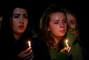 BERKELEY, CA - JUNE 17:  People hold candles as they gather at the Martin Luther King Jr. Civic Center Park to mourn the loss of six students who died in an early Tuesday morning balcony collapse on June 17, 2015 in Berkeley, California. Hundreds of people attended a candlelight vigil for six students who were killed, five of which were in the United States on J1 work visas from Ireland, when a balcony they were standing on collapsed during a birthday party in their Berkeley, California apartment.  (Photo by Justin Sullivan/Getty Images)