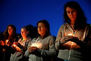 BERKELEY, CA - JUNE 17:  People gather at the Martin Luther King Jr. Civic Center Park to mourn the loss of six students who died in an early Tuesday morning balcony collapse on June 17, 2015 in Berkeley, California. Hundreds of people attended a candlelight vigil for six students who were killed, five of which were in the United States on J1 work visas from Ireland, when a balcony they were standing on collapsed during a birthday party in their Berkeley, California apartment.  (Photo by Justin Sullivan/Getty Images)