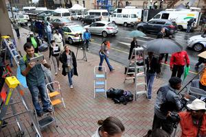 Abandoned step ladders and equipment stand on the pavement outside North Gauteng High Court as Oscar Pistrious slips into court through another door and journalists pursue him on March 3, 2014 in Pretoria, South Africa. (Photo by Christopher Furlong/Getty Images)