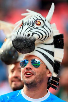 A fan wears a zebra hat in the stands during the Rugby World Cup match at Wembley Stadium, London. PRESS ASSOCIATION Photo. Picture date: Sunday September 20, 2015. See PA story RUGBYU New Zealand. Photo credit should read: Mike Egerton/PA Wire. RESTRICTIONS: Editorial use only. Strictly no commercial use or association without RWCL permission. Still image use only. Use implies acceptance of Section 6 of RWC 2015 T&Cs at: http://bit.ly/1MPElTL Call +44 (0)1158 447447 for further info.