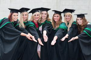 No Fee for Reproduction  Graduating from the Ulster University today with a degree in Social Work are, Lisa McKenna, Shannon Dunlop, Aimee Garvey, Bernie Cross, MIchaella McLean,Urulsa Begley and Amy Dagens. Picture Martin McKeown. Inpresspics.com. 20.06.15