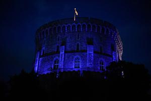 Windsor Castle is turned blue to salute local heroes during Thursday's nationwide Clap for Carers NHS initiative to applaud NHS workers fighting the coronavirus pandemic when landmarks across the UK will be lit blue. PA Photo. Picture date: Thursday April 2, 2020. See PA story HEALTH Coronavirus. Photo credit should read: Kirsty O'Connor/PA Wire