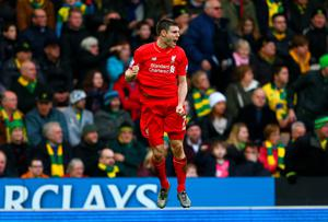 NORWICH, ENGLAND - JANUARY 23:  James Milner of Liverpool celebrates scoring his team's fourth goal during the Barclays Premier League match between Norwich City and Liverpool at Carrow Road on January 23, 2016 in Norwich, England.  (Photo by Clive Mason/Getty Images)