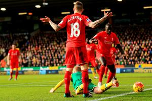 NORWICH, ENGLAND - JANUARY 23:  Alberto Moreno of Liverpool reacts after his challenge on Steven Naismith of Norwich City resulting in the penalty kick during the Barclays Premier League match between Norwich City and Liverpool at Carrow Road on January 23, 2016 in Norwich, England.  (Photo by Stephen Pond/Getty Images)