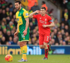 NORWICH, ENGLAND - JANUARY 23:  James Milner of Liverpool celebrates scoring his team's fourth goal during the Barclays Premier League match between Norwich City and Liverpool at Carrow Road on January 23, 2016 in Norwich, England.  (Photo by Stephen Pond/Getty Images)
