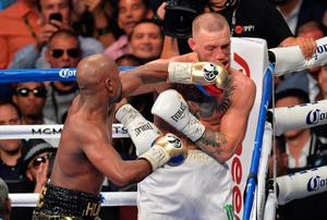 Floyd Mayweather Jnr defeats Conor McGregor during their fight at the T-Mobile Arena, Las Vegas. PRESS ASSOCIATION Photo. Picture date: Saturday August 26, 2017. See PA story BOXING Las Vegas. Photo credit should read: Lionel Hahn/PA Wire. RESTRICTIONS: Editorial use only. No commercial use.