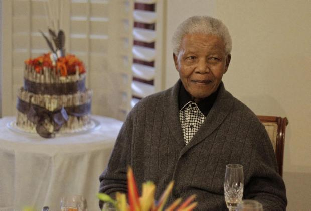 Former South African President Nelson Mandela celebrating his 94th birthday with family in Qunu, South Africa, on July 18, 2012. (AP Photo/Schalk van Zuydam-file)