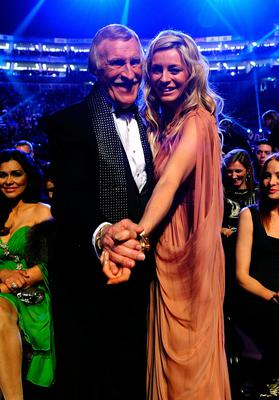 Sir Bruce Forsyth and Tess Daly during the 2011 National Television Awards at the O2 Arena, London. Ian West/PA Wire