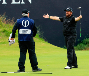 Champion Shane Lowry of Ireland celebrates with caddie Bo Martin on the 18th green