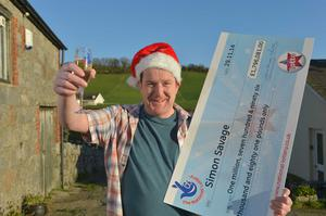 Newry man Simon Savage has been revealed as Northern Irelands latest National Lottery millionaire after scooping a massive ?1,796,081 jackpot that he so very nearly missed out on.  Simon saw media reports of a huge unclaimed Lotto prize in the Newry and Mourne area and when he checked tickets he had lying around the house he realised that he was the winner.