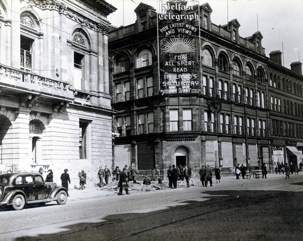 Belfast air raids. April/May 1941: Belfast Telegraph offices boarded up and Central Library on Royal Avenue. AR 21
