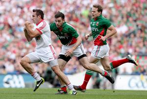 Mayo's Kevin McLoughlin and Andy Moran with Dermot Carlin of Tyrone