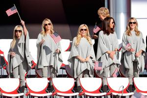 CHASKA, MN - SEPTEMBER 29:  Justine Reed, Nichole Moore, Amy Mickelson, Sybi Kuchar and Becky Edwards wave flags during the 2016 Ryder Cup Opening Ceremony at Hazeltine National Golf Club on September 29, 2016 in Chaska, Minnesota.  (Photo by Jamie Squire/Getty Images)