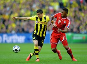 LONDON, ENGLAND - MAY 25:  Robert Lewandowski of Borussia Dortmund (L) in action with Jerome Boateng of Bayern Muenchen during the UEFA Champions League final match between Borussia Dortmund and FC Bayern Muenchen at Wembley Stadium on May 25, 2013 in London, United Kingdom.  (Photo by Shaun Botterill/Getty Images)
