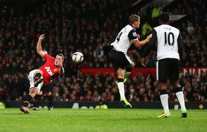 MANCHESTER, ENGLAND - OCTOBER 29: Phil Jones of Manchester United scores his goal during the Capital One Cup fourth round match between Manchester United and Norwich City at Old Trafford on October 29, 2013 in Manchester, England.  (Photo by Clive Brunskill/Getty Images)