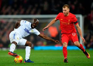 LIVERPOOL, ENGLAND - NOVEMBER 29:  Souleymane Doukara of Leeds United is watched by Ragnar Klavan of Liverpool during the EFL Cup Quarter-Final match between Liverpool and Leeds United at Anfield on November 29, 2016 in Liverpool, England.  (Photo by Laurence Griffiths/Getty Images)