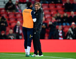 LIVERPOOL, ENGLAND - NOVEMBER 29:  Kyle Bartley of Leeds United and Jurgen Klopp manager of Liverpool shake hands prior to the EFL Cup Quarter-Final match between Liverpool and Leeds United at Anfield on November 29, 2016 in Liverpool, England.  (Photo by Laurence Griffiths/Getty Images)