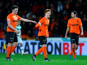 DUNDEE, SCOTLAND - JANUARY 15 Simon Murray of Dundee United is congratulated by John Soutter after scoring a goal in the first half during the Ladbrokes Scottish Premiership match between Celtic FC and Dundee United FC at Tannadice Park on January 15, 2016 in Dundee, Scotland. (Photo by Mark Runnacles/Getty Images)