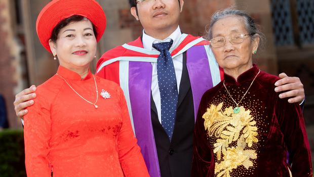 Long Nguyen from Vietnam is pictured with his mother and 95-year-old grandmother who both travelled from Vietnam to celebrate as he graduated from Queen's University Belfast with a PhD in Electrical Engineering.