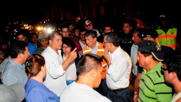 """Picture released by Ecuadorean agency API showing Ecuador's President Rafael Correa (C at left) gesturing during his visit to the city of Manta, Ecuador, on April 17, 2016 a day after a powerful 7.8-magnitude quake hit the country. Ecuador quake kills 272 and the number """"will rise"""", Correa said. / AFP PHOTO / API / Ariel Ochoa / RESTRICTED TO EDITORIAL USE - MANDATORY CREDIT """"AFP PHOTO / API / ARIEL OCHOA"""" - NO MARKETING NO ADVERTISING CAMPAIGNS - DISTRIBUTED AS A SERVICE TO CLIENTSARIEL OCHOA/AFP/Getty Images"""