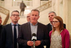 Sinn Fein's Conor Murphy (centre) speaking to the media at Stormont Parliament buildings, Belfast. Pic: Niall Carson/PA Wire