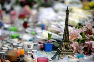 "A miniature Eiffel tower, candles and flowers are seen at a makeshift memorial outside ""Le Carillon cafe"" at the corner of Rue Bichat and Alibert in the 10th arrondissement and ""Le petit Cambodge"" restaurant, at the site of the attacks in Paris, on November 17, 2015 in tribute to the victims of the attacks claimed by Islamic State which killed at least 129 people and left more than 350 injured on November 13. AFP PHOTO / KENZO TRIBOUILLARDKENZO TRIBOUILLARD/AFP/Getty Images"