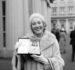 Outside Buckingham Palace after being made a dame in 1975 (PA)