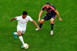 Liverpool's English defender Joe Gomez (L) vies with Bordeaux's forward Enzo Crivelli (R) during the group B, UEFA Europa League football match between Bordeaux vs Liverpool on September 17, 2015 at the Matmut Atlantique Stadium in Bordeaux.  AFP PHOTO / MEHDI FEDOUACHMEHDI FEDOUACH/AFP/Getty Images