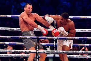 TOPSHOT - Britain's Anthony Joshua (R) throws a punch at Ukraine's Wladimir Klitschko during the fourth round of their IBF, IBO and WBA, world Heavyweight title fight at Wembley Stadium in north west London on April 29, 2017. / AFP PHOTO / Ben STANSALLBEN STANSALL/AFP/Getty Images