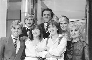 Sir Terry Wogan (back) with Britain's entry into the Eurovision Song Contest Bardo (centre left and right), and members of pop group Bucks Fizz in 1982